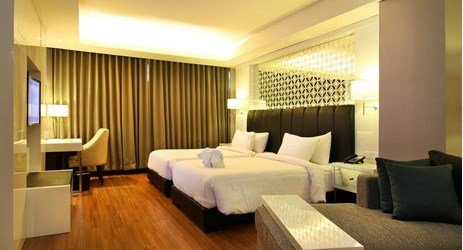 President Suite Room comes with a larger space. With a chic and modern decor, the room has a bright interior and a king-sized bed. Offering non-smoking rooms, ideal choice for the family while staying in Solo
