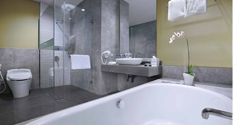 A nicely appointed bathroom with bathtub in a modern stylish classy hotel in mataram lombok