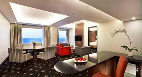 Spacious suite with ocean view adjoined living and dining area in a modern hotel in kupang