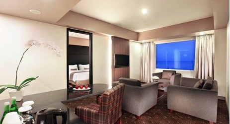 Spacious suite with ocean view adjoined living in a modern hotel in kupang