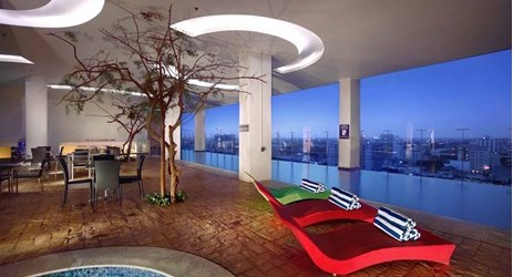 unique design of swimming pools, located on the 15th floor, offer 360 panoramic view of Makassar