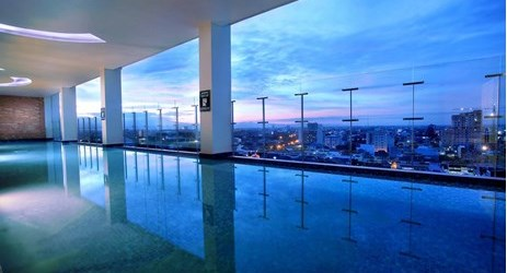unique design of swimming pools, located on the 15th floor, offer 360 panoramic sunset view in makassar
