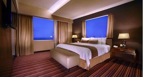 A stylish and spacious room design with elegant furnished, experience the perfect stay at the suite room in makassar
