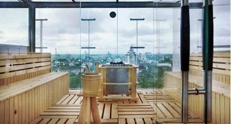 A unique sauna, design with full glass located on higher floor next to the swimming pool in makassar