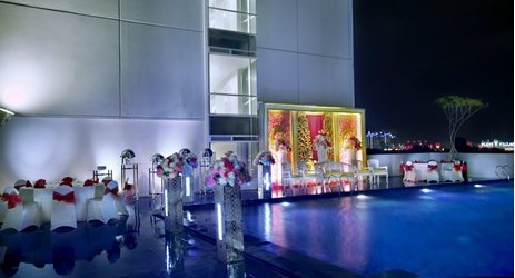 Outdoor wedding party next to the infinity swimming pool is available in the commercial center of North Jakarta
