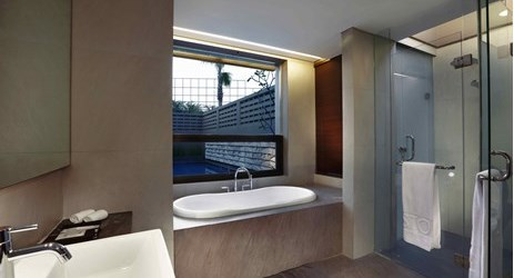 Exclusive private bathroom with rain shower and porcelain bath tub available while staying in the best hotel surrounded by mountain view in Sentul area
