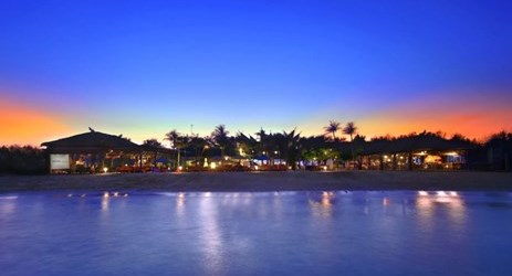 Beautiful beachfront with sunset view of a beautiful resort to stay when visit gili trawangan island lombok for holiday