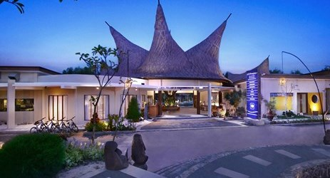 A grand exterior with unique facade of a beautiful resort to stay when visit gili trawangan island lombok for holiday
