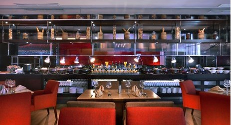 A modern restaurant with trendy design featuring International Buffet and A'la Carte Menu. Outdoor space is available.