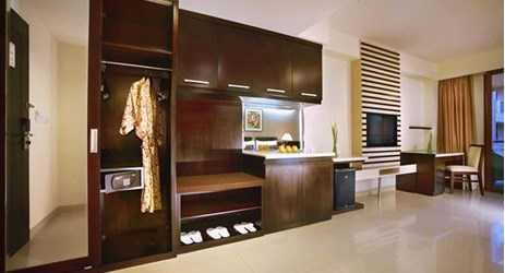 spacious room with complete modern amenities for holiday with family in kuta bali