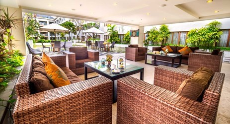 Semi-outdoor entertainment lounge overlooking the swimming pool view in Kuta bali