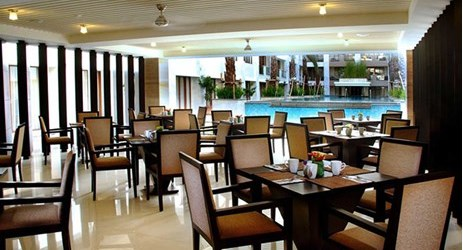 Enjoy breakfast lunch dinner at simple elegant restaurant at the poolside in Kuta bali