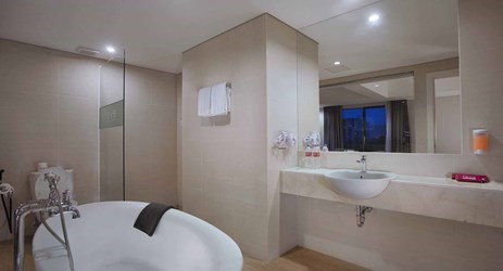 Comfortable bathroom with bathtub in budget Hotel at Makassar