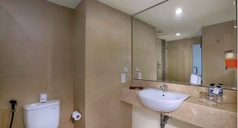 clean and comfortable bathroom of budget hotel while stay and holiday in Seminyak Bali